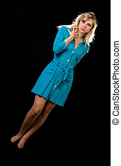 Blue dress - Attractive woman with long blond hair and blue...