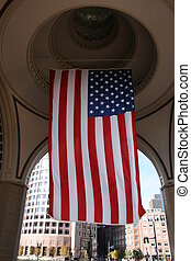 Flag - United States flag hanging from a rotunda.