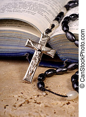 Bible And Crucifix - Open Bible With A Crucifix And Rosaries...