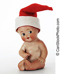 Christmas baby - An antique porcelain baby wearing a...
