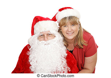Santa & Mrs Claus - Santa Claus and his wife posing for a...
