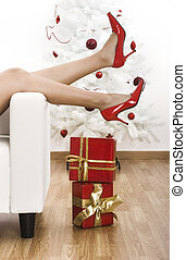 Red shoes - Sexy woman legs with red shoes on a Christmas...