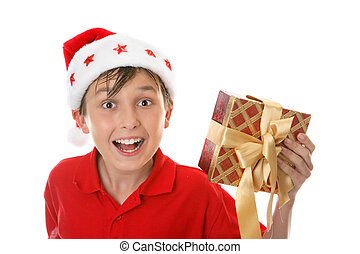 Exuberant child with Christmas gift - Excited jovial child...