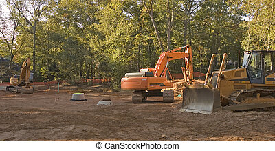 Heavy Equipment in Dirt - Heavy Construction Equipment in a...