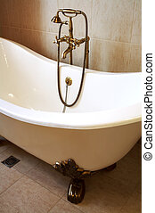 Magnificent bath with a beautiful bronze shower
