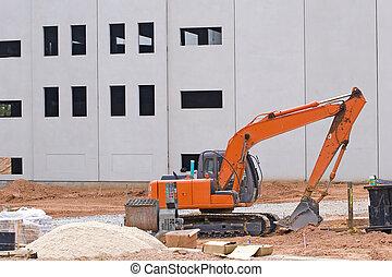 Orange Loader and Sand - An orange front end loader at...