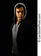 Hooded fashion - Handsome young brunette man wearing a...