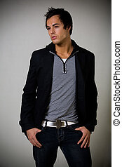 Male casual fashion - Handsome young brunette man wearing a...