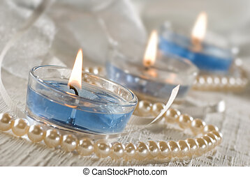 candles - three blue candles decorated close up shoot
