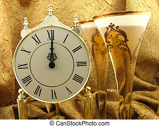 Happy New Year ! - clock and two glasses of champagne on the...