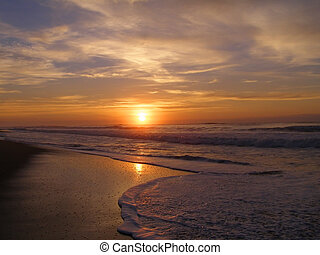 Warm Waters - Warm sunrise over the surf on the Carolina...