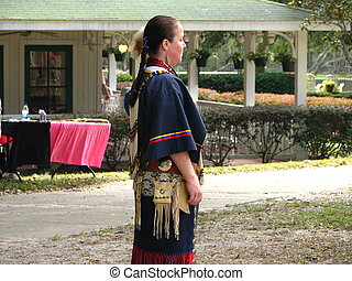 Native American Woman - A native american woman watching a...
