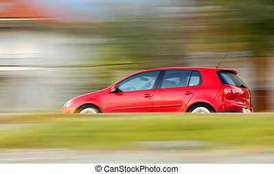 Fast moving red car - This is a panning shot of a fast...