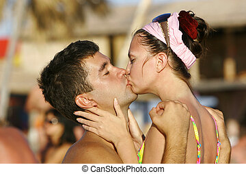 young kissing couple - close up of young kissing couple