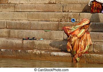Gold sari - Hindu woman wearing gold sari / India