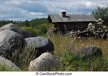 A hermit habitation - A single small wooden hut among the...