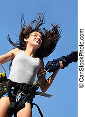 Happy girl - Girl having a good time bungee jumping