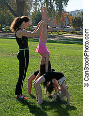 Gymnasts in the park - Coach and her gymnasts in the park