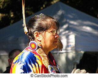 Plains Native American woman dancing at gathering of nations...