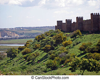 Morocco rabat kasbah - a kasbah on the edge of a hill in...
