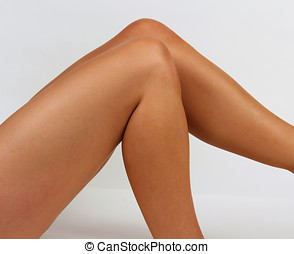 Smooth Legs - Smooth tanned legs against a white backdrop