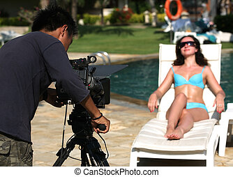 Beautiful woman and video-operator - Video-operator makes...