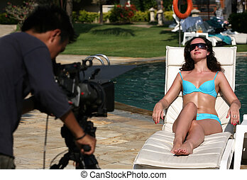 Beautiful woman - Video-operator makes film about rest on...