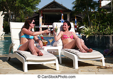 Beautiful women - Two young girls with cocktails near the...