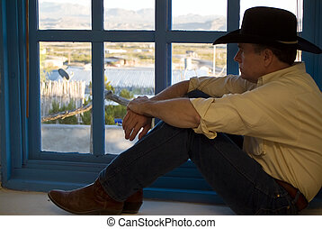 Windowsill Perch - A man dressed in western attire, sitting...