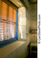 Blinds and Sunshine - Sunlight pouring through the blinds...