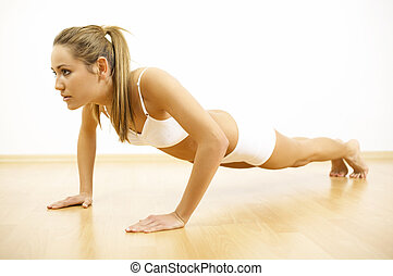 Fitness Time - Young beautiful woman during fitness time and...