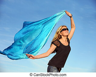 Happiness - Beautiful blond woman running with a blue scarf