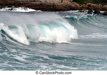 Surging Wave - Surging wave breaking on the coastline of...