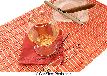 cognac, cigare and spectacles - Glass of brandy, cognac,...