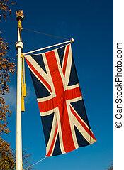 uk flag - flag of united kingdom with blue sky background...
