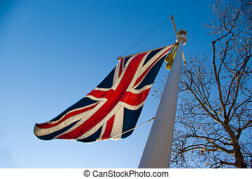 uk flag - flag of united kingdom with blue sky background...