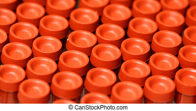 Medical Test Tubes - orange medical test tubes for testing...