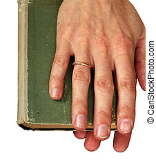 Green book - Man\\\'s hands hold the old green book