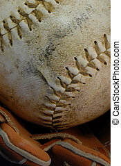baseball and glove - details on well used baseball and glove