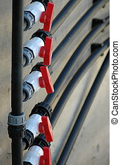 Red valves - Hydraulic system: Five red valves connected to...