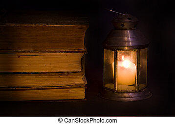 Old books - By the light of a candle old books