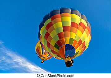 hot air balloons in the sky - two hot air balloons flying in...