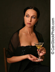 Martini with an olive - The beautiful woman with a glass of...
