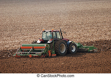 Tractor ploughing field in autumn