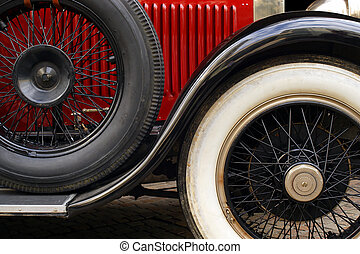 Antique car wheels - The fender and spoked wheels of an...