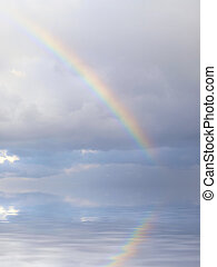 Over the Rainbow - Real rainbow formed during rainfall in...