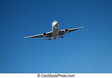 Airliner in blue sky - Large airliner approaching the...