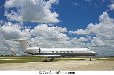 Corporate Jet - Luxury business jet parked at exotic airport