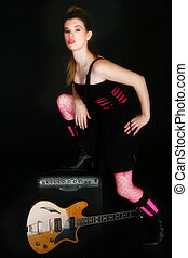 Rocker Chic - Beautiful Hispanic woman with electric guitar...