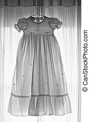 Baby\\\'s White Gown - Baptism gown hung on window, backlit...